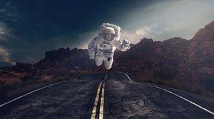 Превью обои астронавт, гравитация, дорога, асфальт, скалы, камни