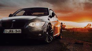 Превью обои bmw, автомобиль, вид спереди, фары, свечение, черный