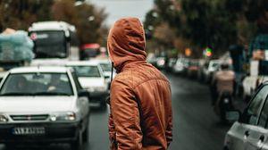Превью обои человек, капюшон, дорога, улица, машины