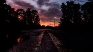 Превью обои дорога, закат, разметка, деревья