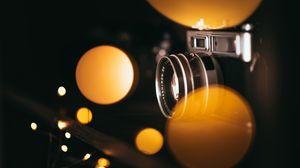 Превью обои фотоаппарат, боке, размытость, огни, объектив
