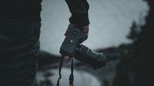 Превью обои фотоаппарат, фотограф, темный, силуэт