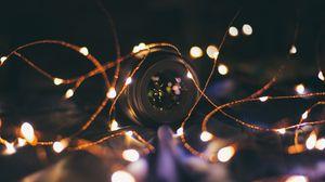 Превью обои гирлянда, объектив, камера, лампочки, свет