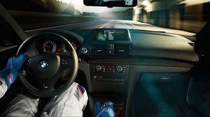 Превью обои гонщик, салон, бмв, скорость, трасса