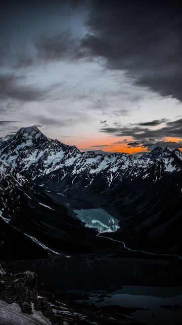 360x640 Обои горы, озеро, вершины, вид сверху