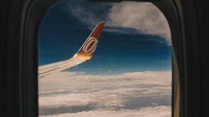 Превью обои иллюминатор, окно, крыло самолета, полет, облака