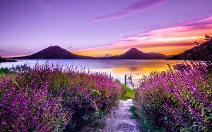 Превью обои озеро, горы, одиночество, цветение, атитлан, гватемала