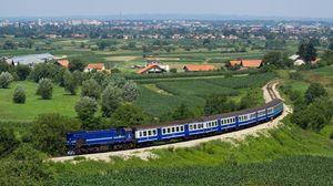 Превью обои поезд, состав, синий, поля, деревья, сверху, город, окраина, даль, лето, железная дорога