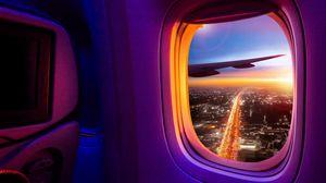 Превью обои самолет, иллюминатор, окно, обзор, город