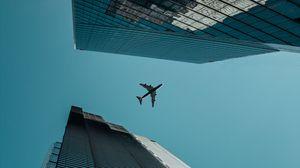 Превью обои самолет, вид снизу, здания, небоскребы, архитектура
