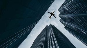 Превью обои самолет, здания, небоскребы, небо