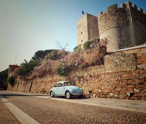 Превью обои автомобиль, синий, ретро, башня, архитектура
