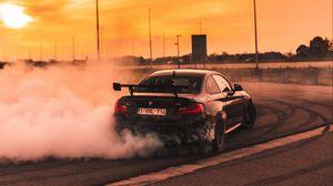 Превью обои bmw, скорость, дрифт, дым, закат