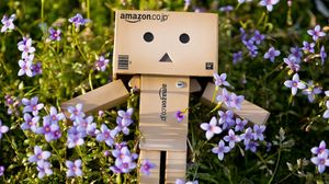 Превью обои danboard, картонный робот, цветы, трава