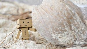 Превью обои danboard, картонный робот, песок, камень