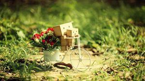 Превью обои danboard, велосипед, картонные роботы, цветы, трава