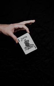 Превью обои джокер, игральная карта, карта, слово, рука