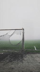 Превью обои футбольные ворота, рваный, туман, газон, настроение, мрачный