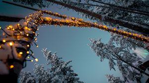 Превью обои гирлянды, снег, деревья, декорация, зима