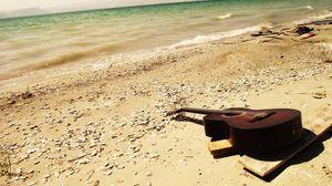 Превью обои гитара, море, пляж, музыка
