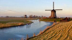 Превью обои голландия, мельница, озеро, песок, трава, небо