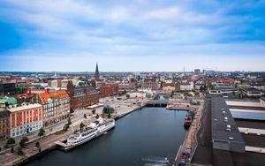 Превью обои город, здания, архитектура, река, лодка, вид сверху