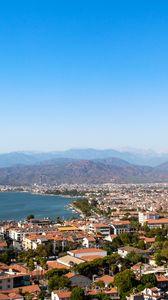 Превью обои город, здания, крыши, архитектура, горы, вид сверху
