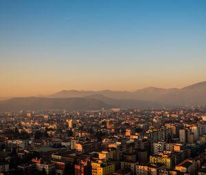 Превью обои город, здания, крыши, горы, вид сверху