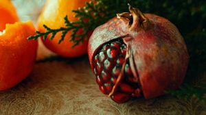 Превью обои гранат, мандарины, фрукты