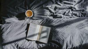 Превью обои книга, кофе, постель, тень