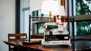 Превью обои книги, стол, лампа