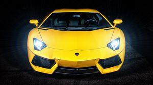 Превью обои lamborghini, желтый, спорткар, свет фар, вид спереди