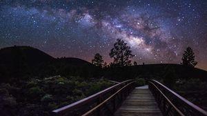 Превью обои млечный путь, звезды, небо, деревья, силуэты, ночь