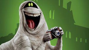 Превью обои монстр, улыбка, смех, фотоаппарат