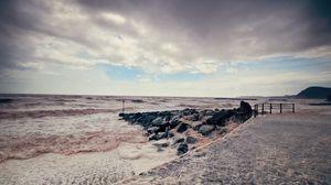 Превью обои море, шторм, пирс, вода, камни, цвета