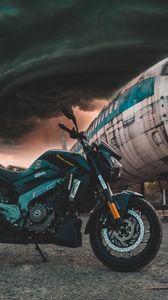Превью обои мотоцикл, самолет, вид сбоку, облака, пасмурно