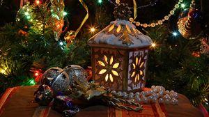 Превью обои новый год, рождество, елка, фонарь, игрушки, гирлянды, украшение