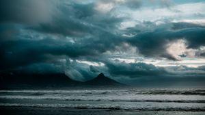 Превью обои океан, прибой, скалы, облака, пасмурно, шторм