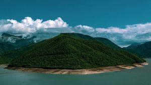 Превью обои остров, берег, холмы, облака, лес, растительность