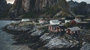 Превью обои остров, скалы, дома, побережье, деревня, норвегия