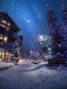 Превью обои рождество, новый год, зима, улица, снегопад, настроение