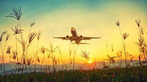 Превью обои самолет, трава, взлет, небо, закат, рассвет