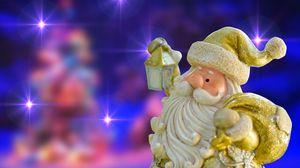 Превью обои санта клаус, дед мороз, статуэтка, игрушка, новый год, рождество, блеск