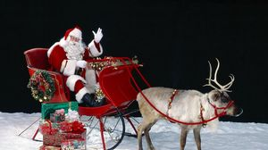 Превью обои санта клаус, олень, сани, мешок, подарки, снег