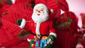 Превью обои санта клаус, рождество, игрушка, мешок, цветы