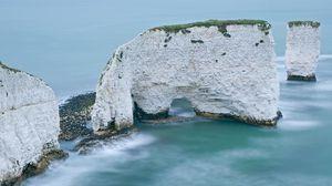 Превью обои скалы, белые, арка, рифы, море, пустота