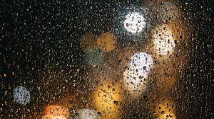 Превью обои стекло, капли, боке, дождь, мокрый, поверхность, огни