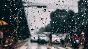 Превью обои стекло, капли, дождь, влага, размытость, город