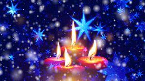 Превью обои свечи, звезды, снежинки, блеск