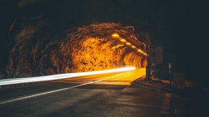 Превью обои туннель, подсветка, движение, темный, скала, длинная выдержка, дорога, ночь